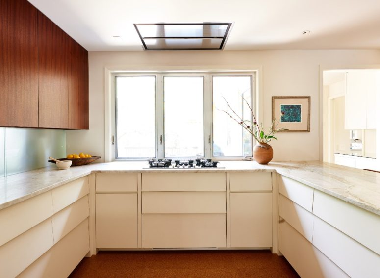 a neutral kitchen design with particle countertops