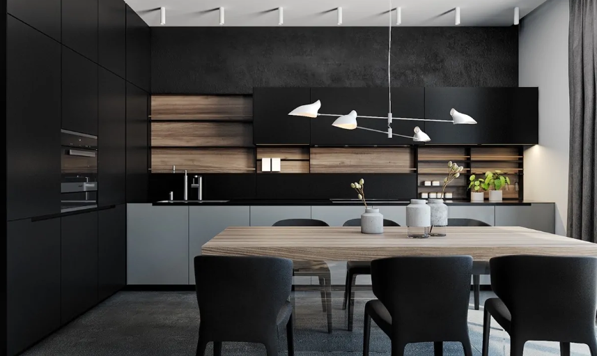 a minimalist black kitchen made cozier and more welcoming with a wooden backsplash and a wooden table next to it