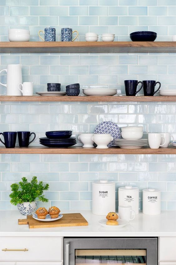 stylish minimalist shelves in front of a blue tile wall look outstanding and will make your objects displayed the best way possible
