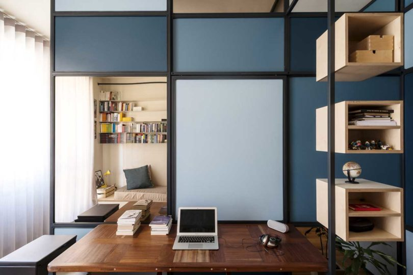 a small home office with a partition wall that separates it