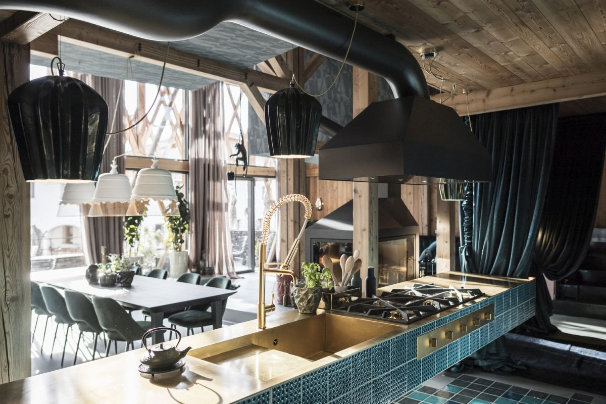 a stylish kitchen design in turquoise tones