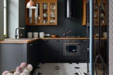 07 a cozy eclectic kitchen done with rich-colored cabinets and countertops, with copper pendant lamps