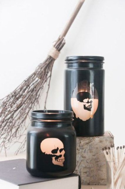jars painted black with skull stencils on them are a nice Halloween-like idea to rock and will fit a modern party