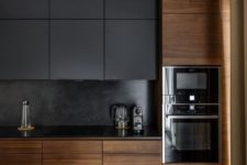 08 a dark black kitchen with sleek wooden cabinets that make it cozier and more welcoming