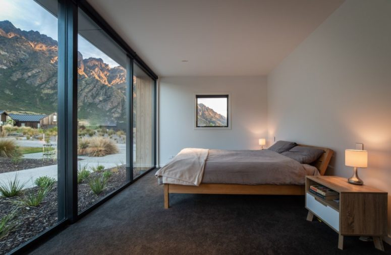 The bedrooms are small and opened to outdoors, there are glazed walls to enjoy the landscape