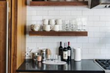 09 just a couple of thick rich-stained wooden shelves that match the wood of the cabinets for a cohesive look