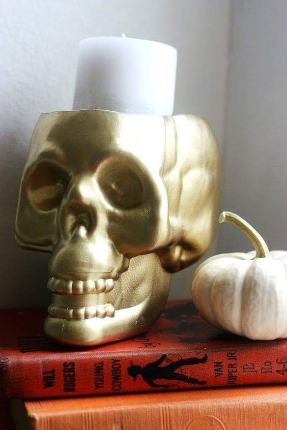 a gold skull candleholder can be eaisly DIYed and used anytime for Halloween decor, it will match most of themes