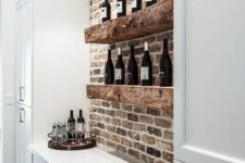 10 extra thick rough wooden shelves in front of a brick wall will definitely add texture and interest to your space