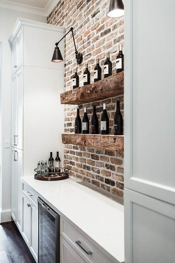 extra thick rough wooden shelves in front of a brick wall will definitely add texture and interest to your space