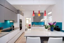 11 a minimalist open layout refreshed with bright blue ktchen backsplashes and bold red pendant lamps over the table