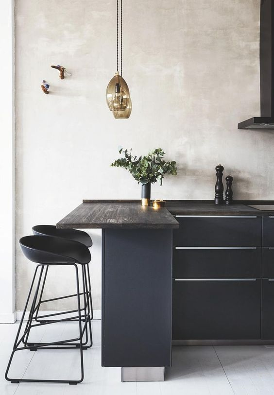 a black kitchen refreshed with neutral plaster walls and a white tile floor has a totally different look than a solid blakc one