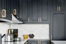 13 a black farmhouse kitchen refreshed wiith a white marble tile backsplash and metallic handles plus a sunburst lamp