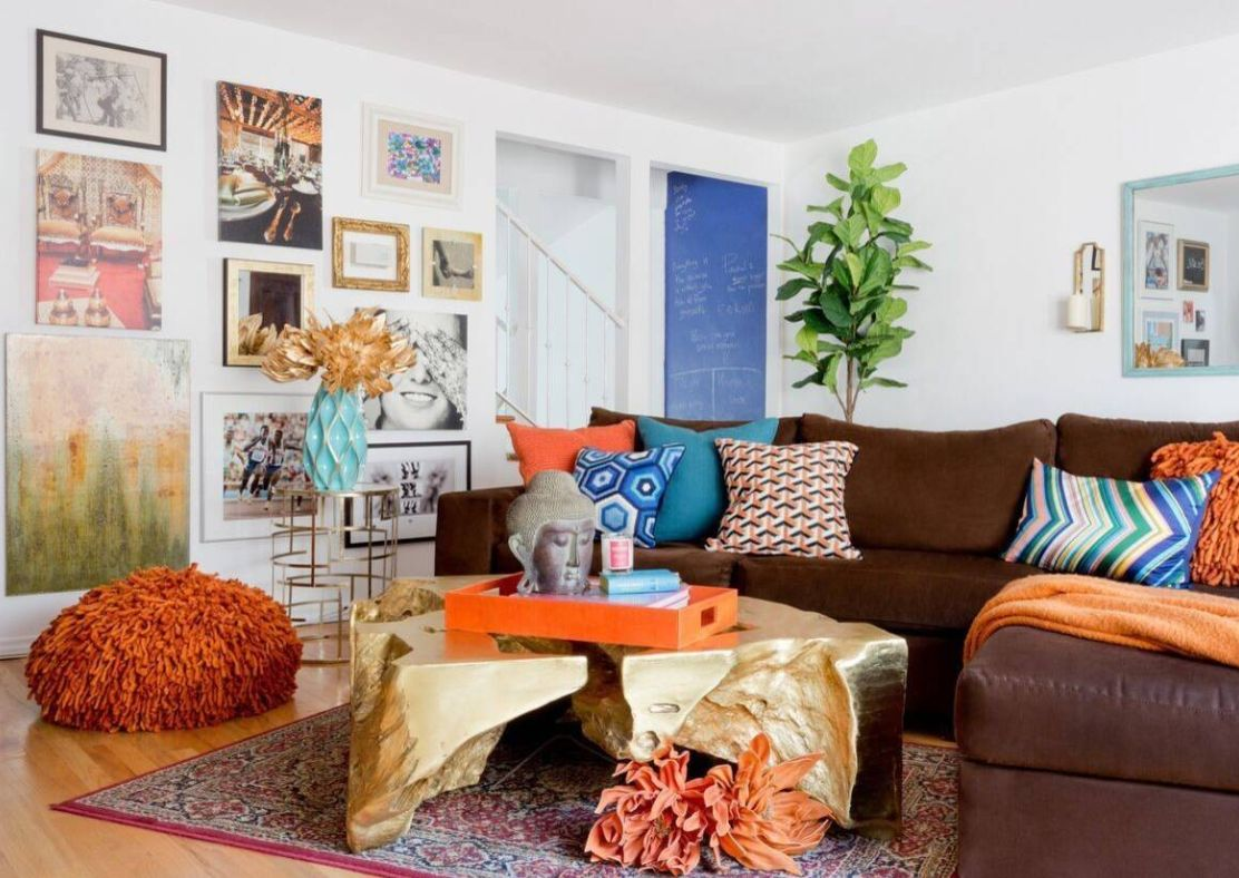a colorful living room done with loads of cobalt blue, turquoise, rust and deep red looks bright and fun