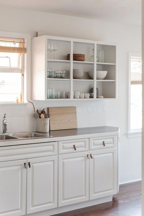 closed lower cabinets and open upper ones for a neutral and simple farmhouse kitchen