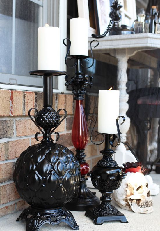 turn thriftstore lamps into Halloween candleholders and paint them black to make the decor more refined and elegant