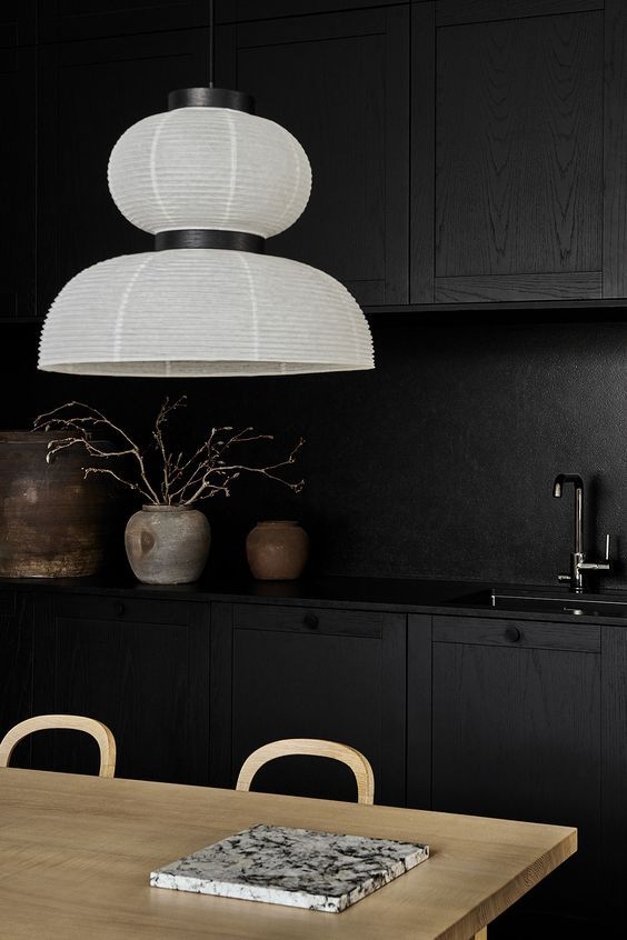 hang a simple white paper chandelier and it will refresh your kitchen without much effort