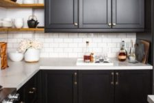 15 a black farmhouse kitchen refreshed with a white wall and a white subway tile backsplash for a contrasting look