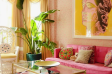 18 a colorful living room in yellow and hot pink, with a refined feel and chic gold touches for a sophisticated look