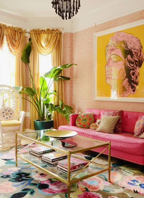 a colorful living room in yellow and hot pink, with a refined feel and chic gold touches for a sophisticated look