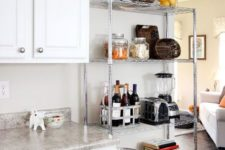 18 a lightweight metal shelving unit next to your traditional cabinets will give a more industrial feel to the space