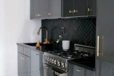 19 a modenr black kitchen refreshed with white surfaces and with gold handles all over that add a touch of glam
