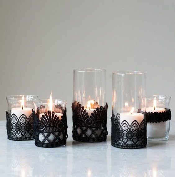 black lace candleholders are an elegant and chic craft for Halloween, they can be crafted in two minutes