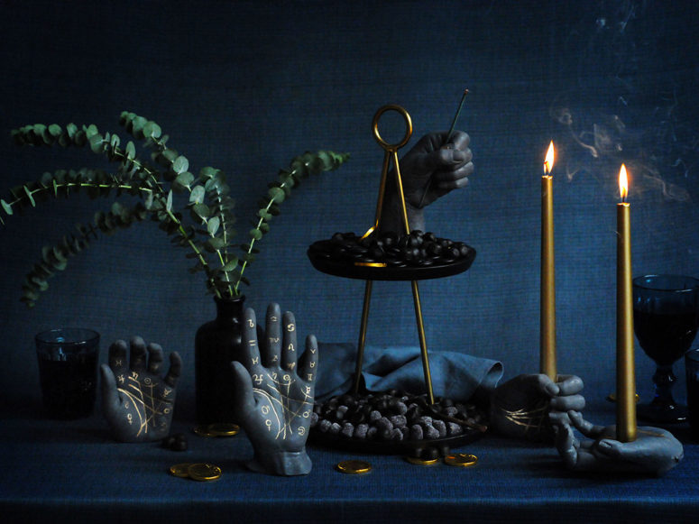 black palmistry Halloween candleholders and decorations with gold runes look bold and contrasting