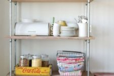 20 place a large industrial shelving unit in your kitchen to store everything you may need