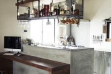 21 a small kitchen with an industrial shelving unit floating over the kitchen island is a stylish and comfortable idea