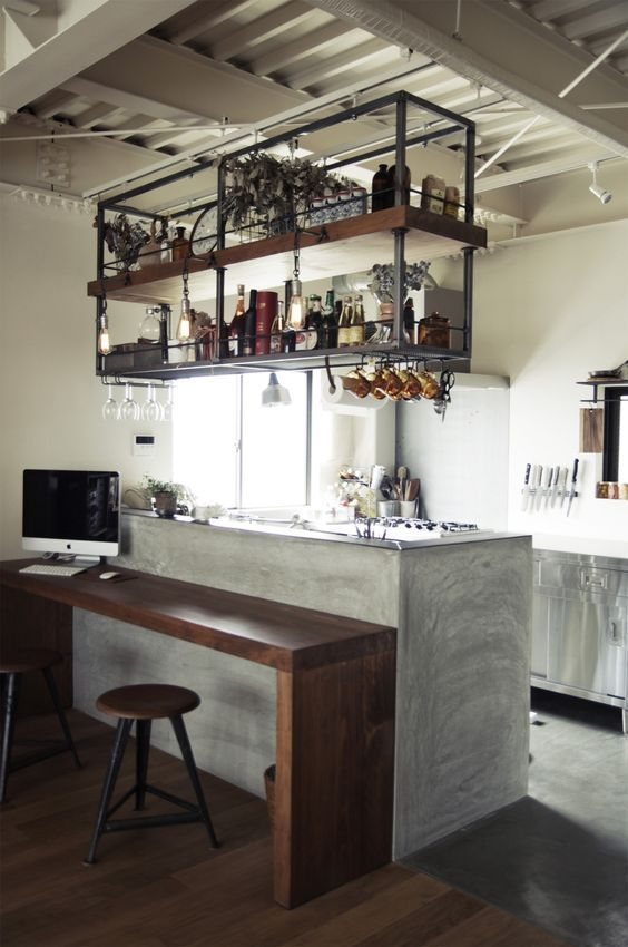 a small kitchen with an industrial shelving unit floating over the kitchen island is a stylish and comfortable idea