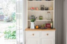 22 a small and cozy white buffet in the corner of your kitchen will give a nice farmhouse touch to the space