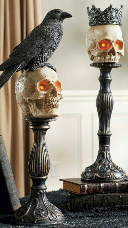 refined metal candleholders can be used as holders for skulls and other types of decor, too