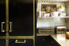 24 a creative and bold black kitchen spruced up with gold elements and matching metal countertops looks super glam