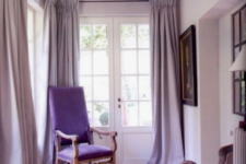 24 a sophisticated lilac space with a purple chair and elegant artworks will make any room refined and gorgeous