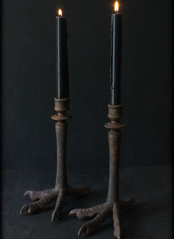rusted antique bird claw candle sticks with black candles are a gorgeous and non-traditional idea to try