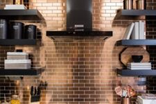 26 a modern black kitchen with a white countertop and a copper tile backsplash for a bright and shiny accent