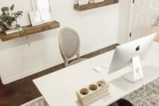 a cozy and simple home office with floating shelves, a simple white desk and a refined chair plus a printed rug