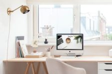 a simple and neutral home office with wooden beams, a comfy desk with a drawer unit, a stylish chair and a view