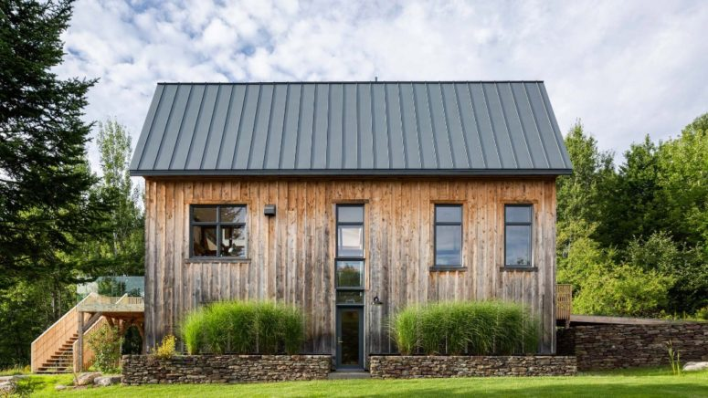 This barn house was created of an abandoned shed, the wood from which was preserved to make the barn