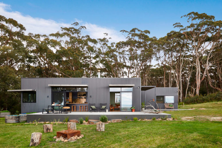 This modern home was built in Australia and clad with grey corrugated steel siding to give it a fresh modern look