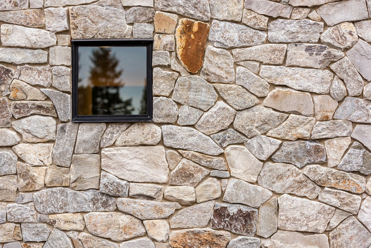 The house is clad with locally sourced wood and stone, which help it blend with the surroundings