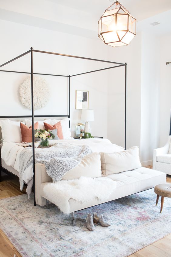 a minimalist canopy bed of dark metal is a stylish idea to highlight your sleeping space