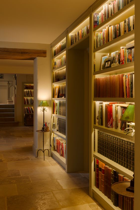 make your bookshelves stand out a lot with built-in lights like these ones and your space will also seem larger thanks to it