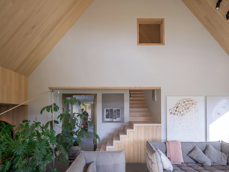 The interiors are light-filled, with much light-colored wood and neutral furniture