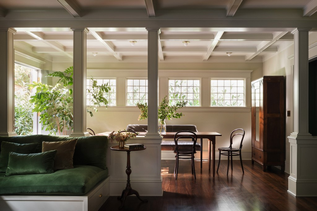 There's a breakfast space with wooden furniture and much natural light