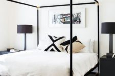 03 a black canopy bed with gilded corners looks very elegant and chic setting the tone in the bedroom