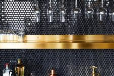 03 a black penny tile backsplash and gold shelves and fixtures make up a very chic and refined combo