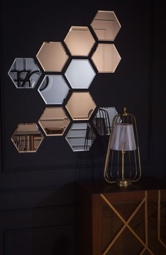 an arrangement of silver and copper hexagon mirrors will make any blank wall stand out