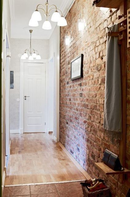 make your entryway much more catchy with an exposed brick wall like this one