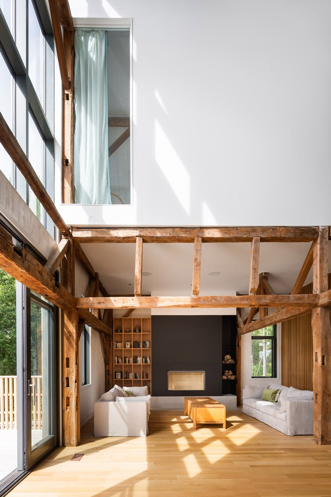 The interiors are contemporary and laconic, with touches of warm-colored wood and plywood